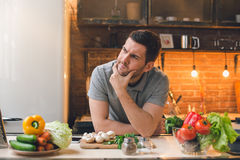 Young Man Vegan Healthy Food Meal Preparation. Young man vegan cooking healthy vegetable salad for dinner Royalty Free Stock Photos