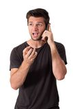 Young Man very angry talk on phone Stock Images