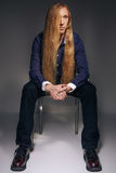 Young man with very long and blond hair Royalty Free Stock Photos