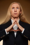 Young man with very long and blond hair Royalty Free Stock Image