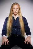Young man with very long and blond hair Stock Photography