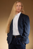 Young man with very long and blond hair Stock Images