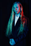 Young man with very long and blond hair Royalty Free Stock Photo