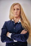 Young man with very long and blond hair Royalty Free Stock Photography