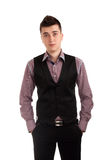 Young man in a vest. Portrait of a young man in a vest over white background royalty free stock photos