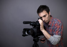 Young man with video camcorder Royalty Free Stock Photography