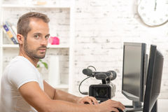 A young man video editor. With computer stock photo