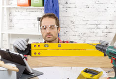 Young man viewing a spirit level Stock Photo