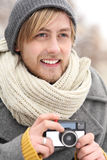 Young man with vintage camera Royalty Free Stock Images