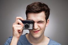 Young man with vintage camera Stock Photography