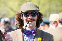 Young man in vintage clothes, sunglasses and a smoking pipe Royalty Free Stock Photo