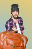 Young man with vintage leather suitcase isolated on white background Stock Photo
