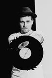 Young man with a vinyl record Royalty Free Stock Image