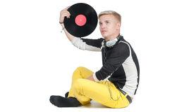 Young man with vinyl record Stock Photo