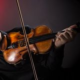 Young man with violin Stock Photos