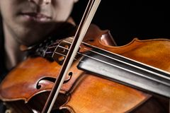 Young man with violin Royalty Free Stock Image