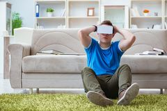 The young man with virtual glasses. Young man with virtual glasses Stock Image