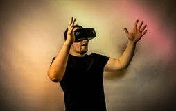 Young man with virtual reality glasses. Modern technologies. Image contains excessive noise, film grain, compression artifacts. And posterization due to special stock photography