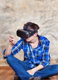 Young Man in VR Glasses Stock Images