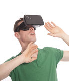 Young man with virtual reality glasses Stock Images