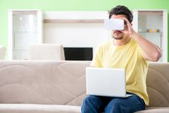 The young man with virtual reality goggles royalty free stock images