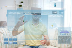 Young man in virtual reality headset or 3d glasses Stock Images