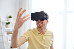 Young man in virtual reality headset or 3d glasses Stock Photography