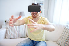 Young man in virtual reality headset or 3d glasses Stock Photo