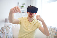 Young man in virtual reality headset or 3d glasses Stock Image