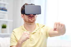 Young man in virtual reality headset or 3d glasses Royalty Free Stock Image