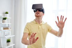 Young man in virtual reality headset or 3d glasses Royalty Free Stock Images