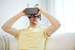 Young man in virtual reality headset or 3d glasses Royalty Free Stock Photo
