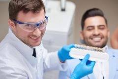 Young man visiting dentist stock photography