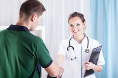 Young man visiting doctor Stock Photography