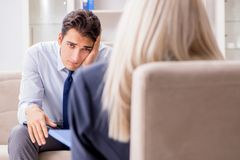 The young man visiting psychiatrist doctor for consultation. Young men visiting psychiatrist doctor for consultation Stock Image