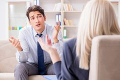 The young man visiting psychiatrist doctor for consultation. Young men visiting psychiatrist doctor for consultation Stock Photography