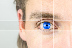 Young man with a vivid blue eye Stock Photography