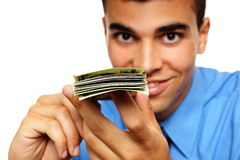 Young man with a wad of banknotes Royalty Free Stock Photography