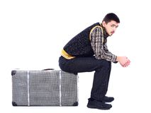 Young man waiting at airport, isolated Royalty Free Stock Photography