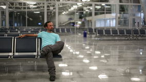 Young man waiting his flight in airport lounge Royalty Free Stock Images