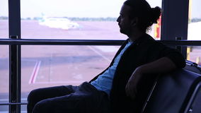 Young man waiting his flight in airport lounge Stock Photo