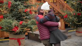 Young Man Waiting for his Girldriend on a Date and Looking at the Clock. Beautiful Woman Comes to a her Boyfriend and. Hugging. Merry Christmas and Happy New stock video footage