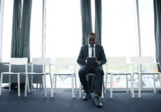 Young man waiting for job interview indoors. Stock Photos
