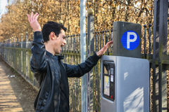 Young man waiting for a parking ticket Royalty Free Stock Photo