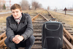 Young man waiting at a rural siding for a train Royalty Free Stock Photos