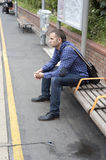 Young man waiting train Stock Image