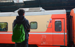 A young man waiting for a train at platform. In Taoyuan station, Taipei, Taiwan Royalty Free Stock Images