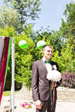 Young man waiting woman.Groom waiting bride.Just married. Close up. Bridal wedding bouquet of flowers Royalty Free Stock Photos