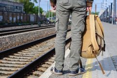 Young man waits train on railway station Royalty Free Stock Photos
