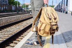 Young man waits train on railway station Stock Images